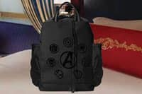 A Disney Cruise Line stateroom with an Avengers backpack on the bed