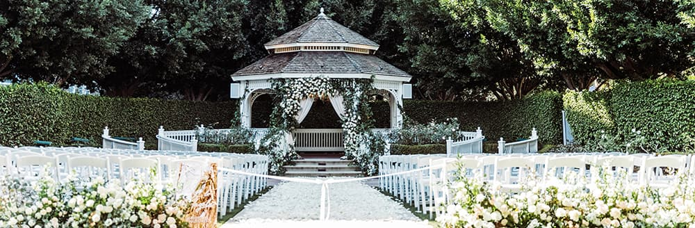 Many chairs face a gazebo in an outside courtyard