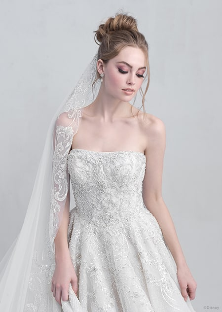 A front side view of a woman wearing the Cinderella wedding gown from the 2021 Disney Fairy Tale Weddings Platinum Collection