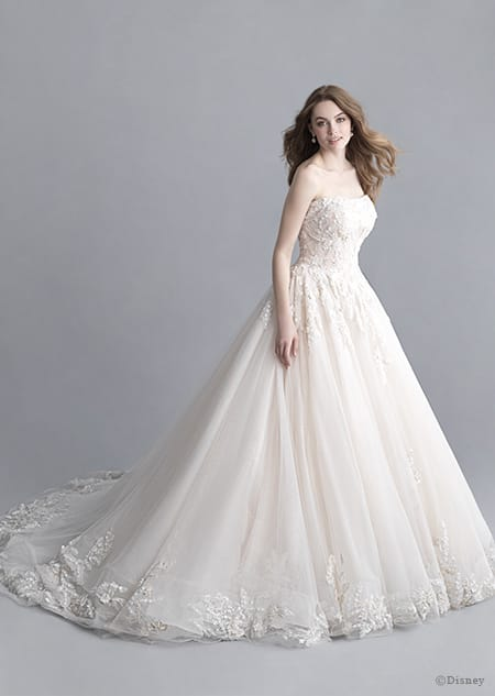 A woman wearing the Aurora wedding gown from the 2020 Disney Fairy Tale Weddings Platinum Collection