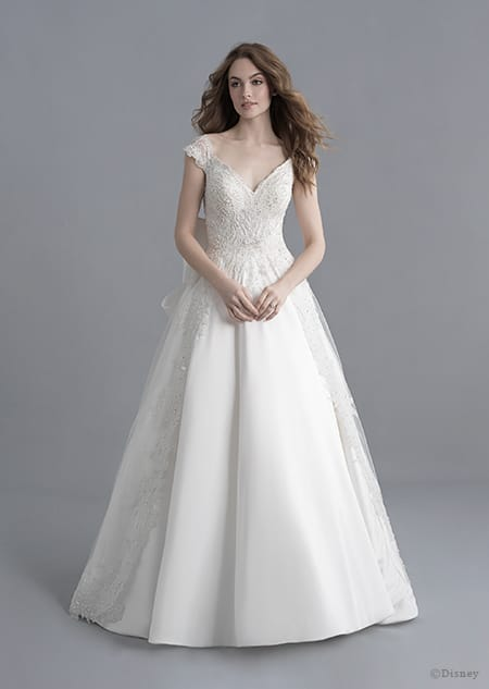 A woman dressed in the Snow White wedding gown from the 2020 Disney Fairy Tale Weddings Platinum Collection