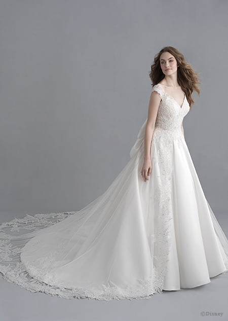 A woman wearing the Snow White wedding gown from the 2020 Disney Fairy Tale Weddings Platinum Collection