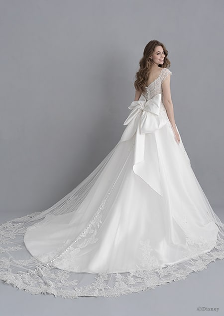 A back side view of a woman in the Snow White wedding gown from the 2020 Disney Fairy Tale Weddings Platinum Collection