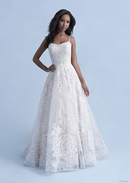 A woman wearing the Belle wedding gown from the 2021 Disney Fairy Tale Weddings Collection