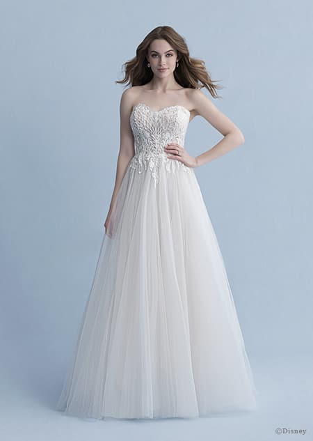 A woman dressed in the Aurora wedding gown from the 2020 Disney Fairy Tale Weddings Collection