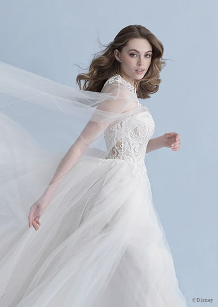 A side view of a woman in the Aurora wedding gown from the 2020 Disney Fairy Tale Weddings Collection