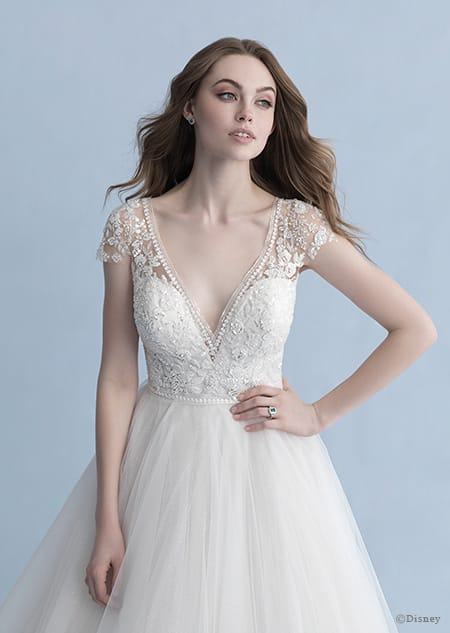 A woman in the Cinderella wedding gown from the 2020 Disney Fairy Tale Weddings Collection