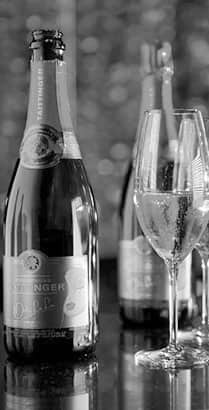 A champagne bottle and a champagne flute