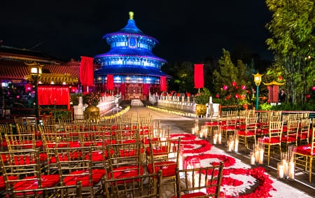 A wedding ceremony setting decorated with candles and an aisle of rose petals at the China Pavilion