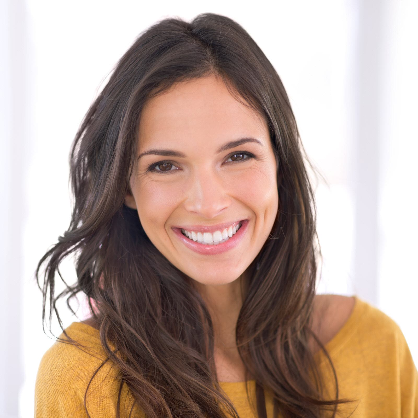 A smiling young woman with long hair