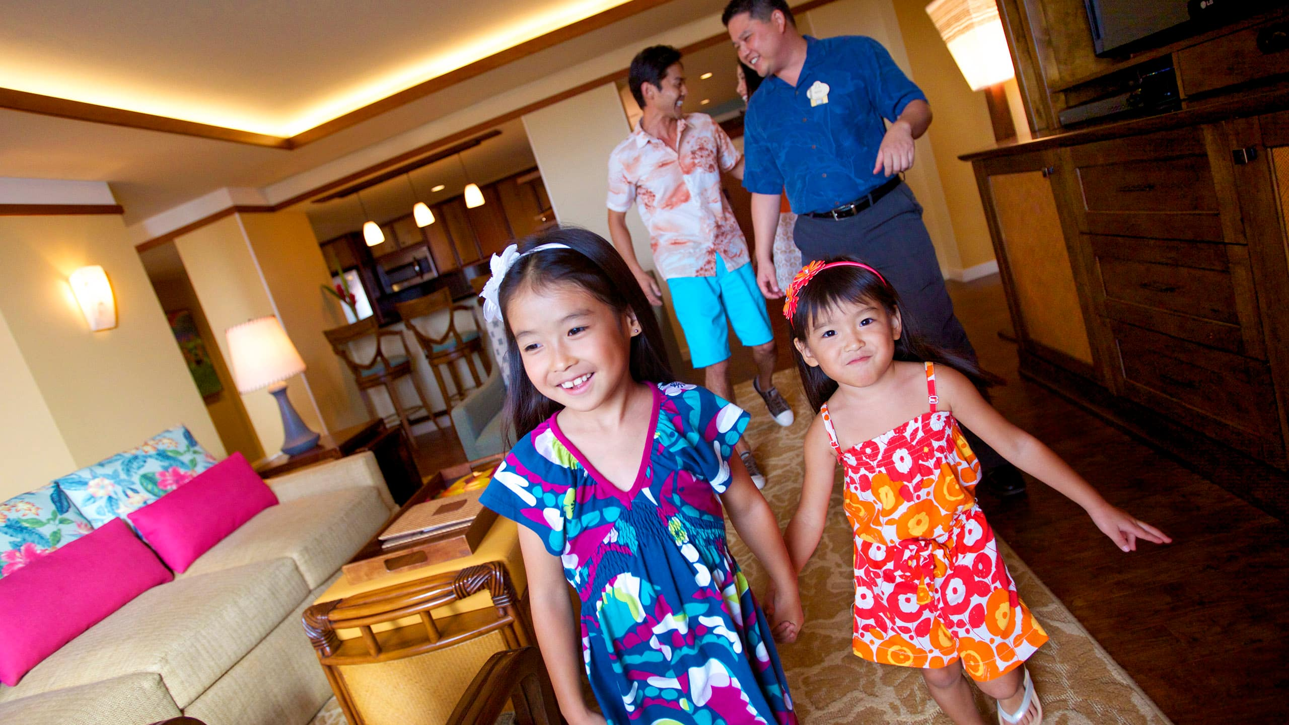 A family walking with a Cast Member through a Disney Vacation Club model villa