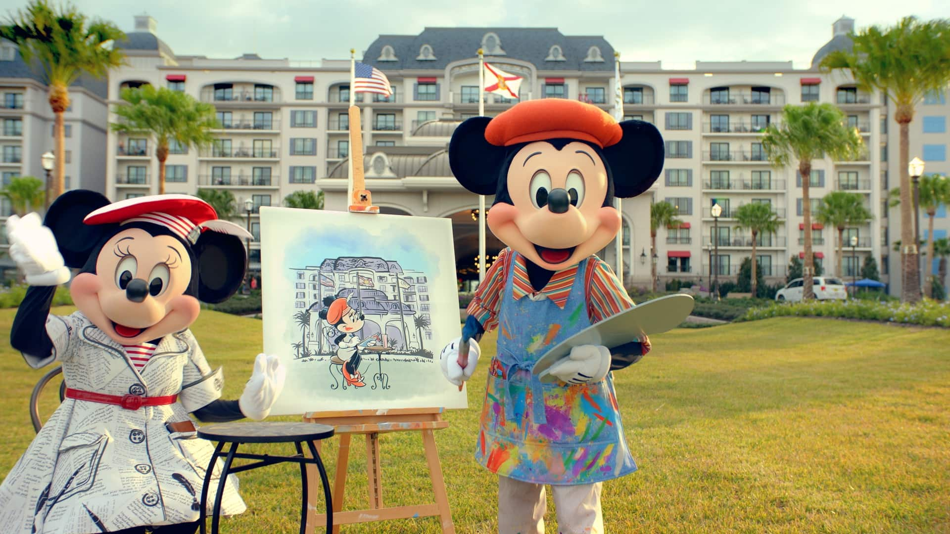 Artist Mickey Mouse paints a portrait of Minnie Mouse in the front lawn at Disney's Riviera Resort