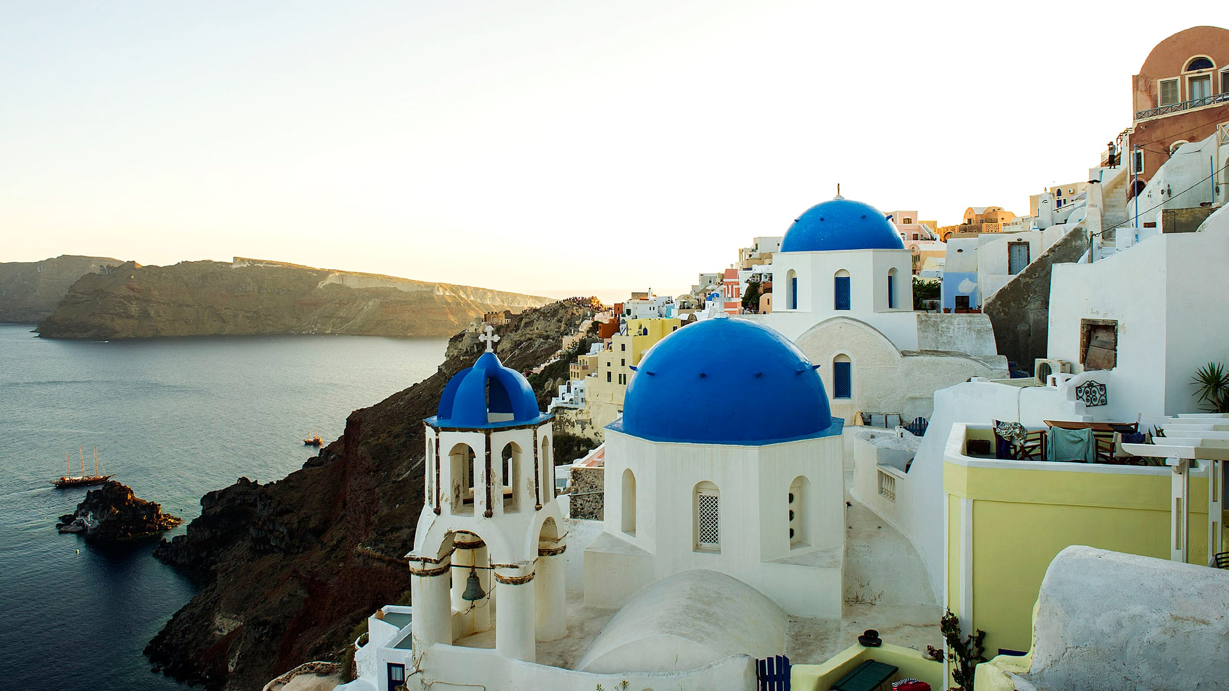 Traditional Greek Cycladic buildings on a cliff in Oia, Greece, overlooking the Aegean Sea
