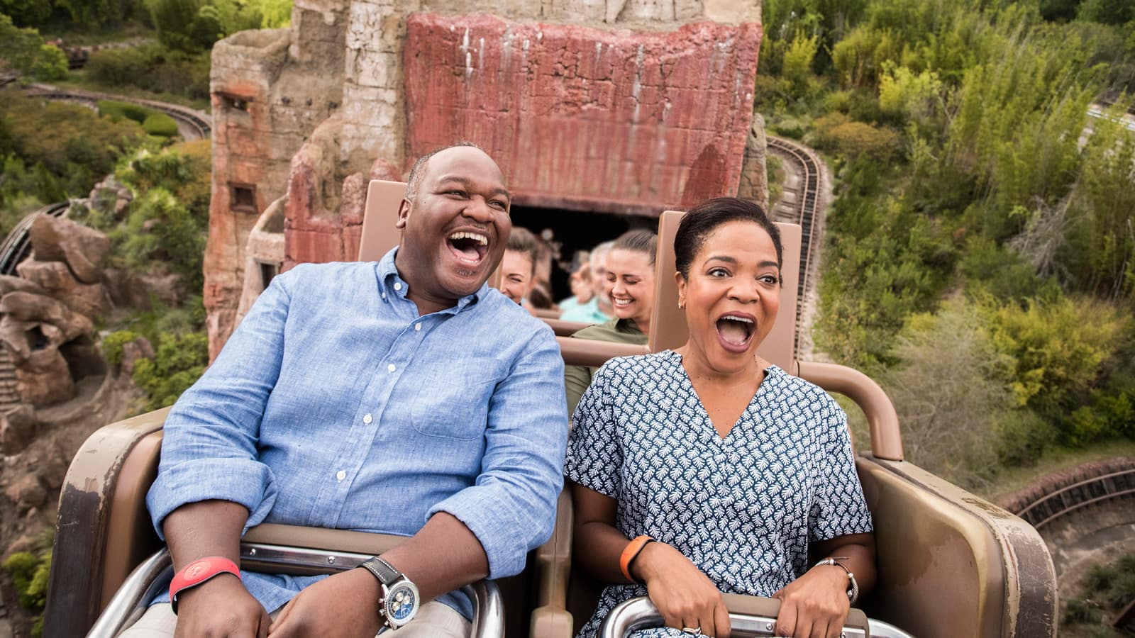 A man and woman screaming with joy while riding the Expedition Everest attraction