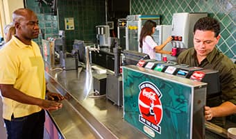 Guests serve themselves at a self-serve beverage counter