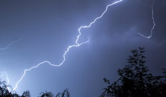 Lightning crackles in a cloudy sky