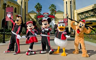 Goofy, Minnie Mouse, Mickey Mouse, Donald Duck and Pluto pose in matching athletic garb