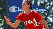 A softball pitcher follows through on a pitch