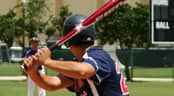 baseball player swings a bat