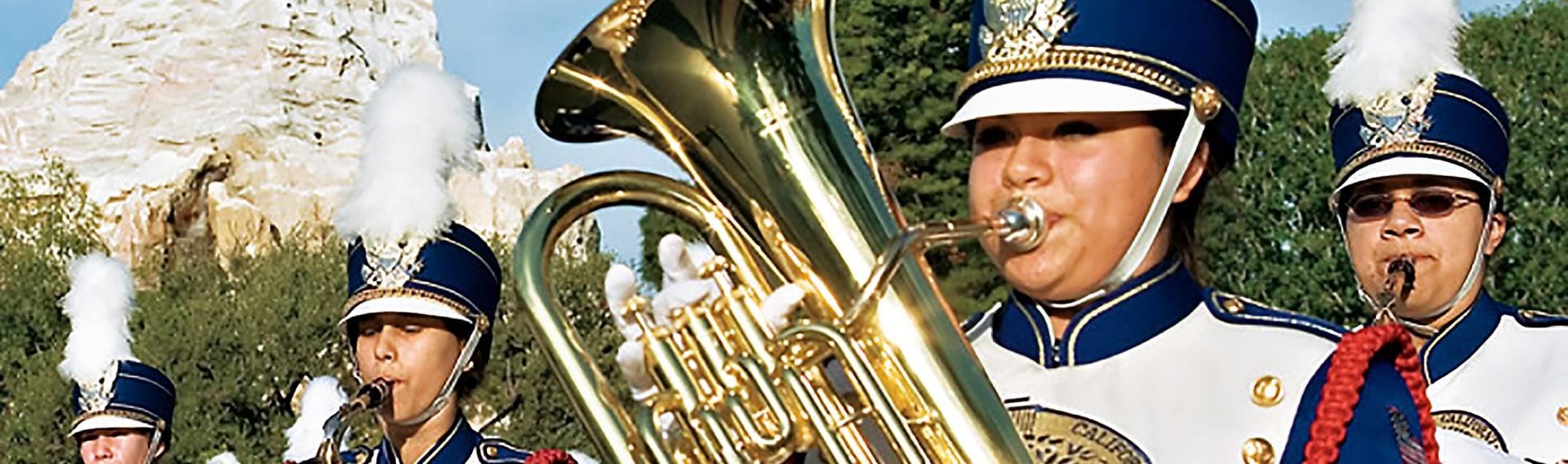 A band playing brass instruments near Matterhorn mountain at Disneyland Park
