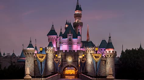 Sleeping Beauty Castle illuminated at night at Disneyland Park