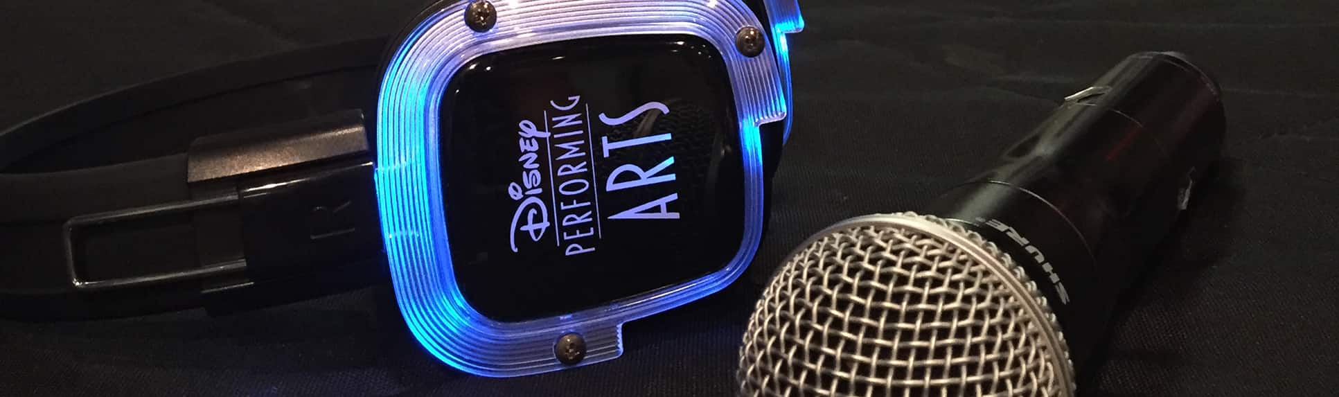 A microphone next to headphones that say Disney Performing Arts