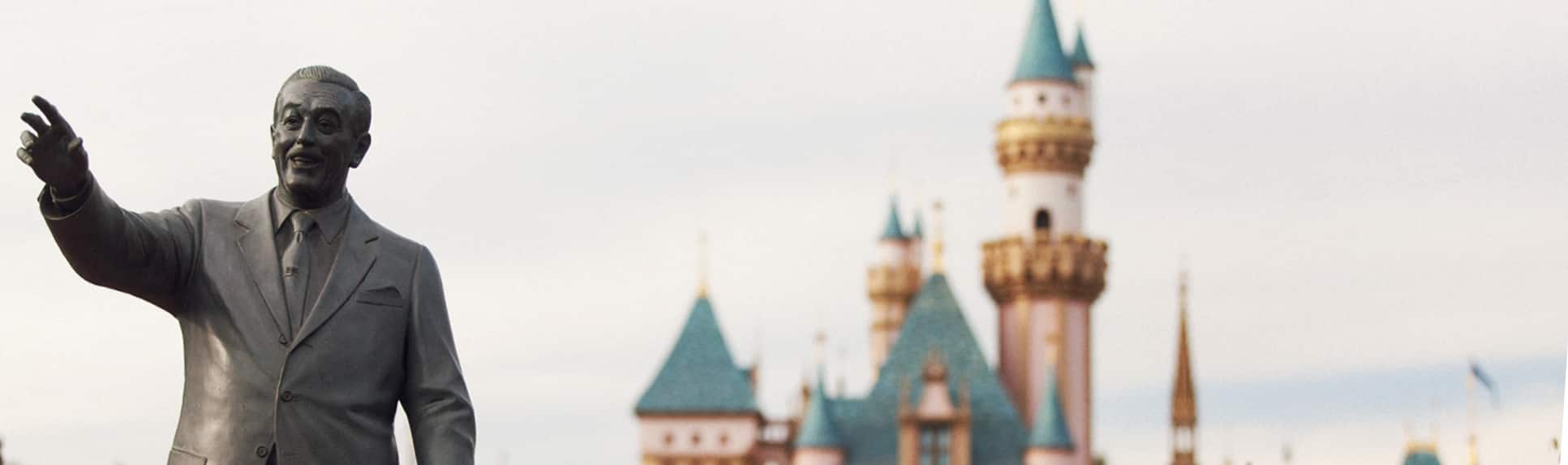 Statue of Walt Disney in front of Sleeping Beauty Castle